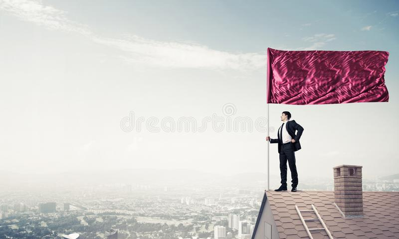 Young businessman with flag presenting concept of leadership. Mi stock images