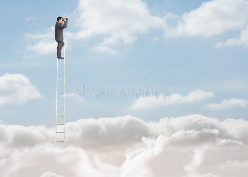 Businessman standing on a ladder over the clouds. And looking at the horizon with binoculars stock photos