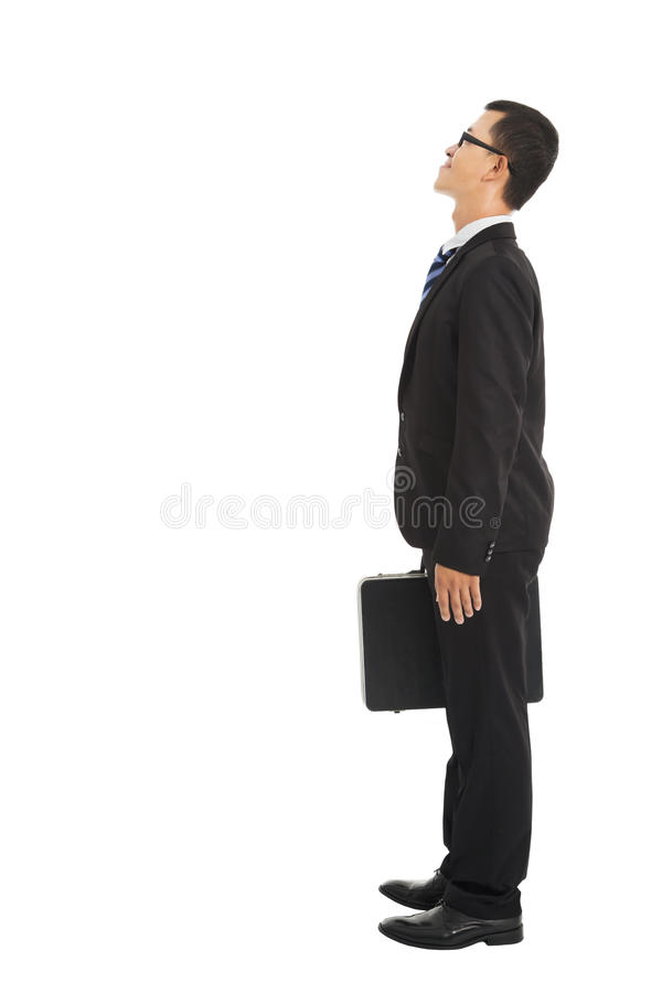 Businessman standing and looking royalty free stock photo