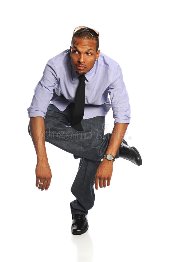 Businessman Standing On One Foot Stock Photo
