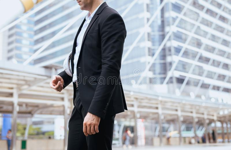 Businessman standing outdoor in city,Lifestyle with positive attitude expressing energy in good time royalty free stock images