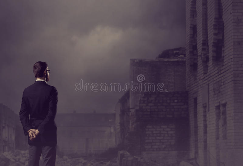 Businessman standing over apocalyptic background. Crisis, default, setback concept. royalty free stock photos