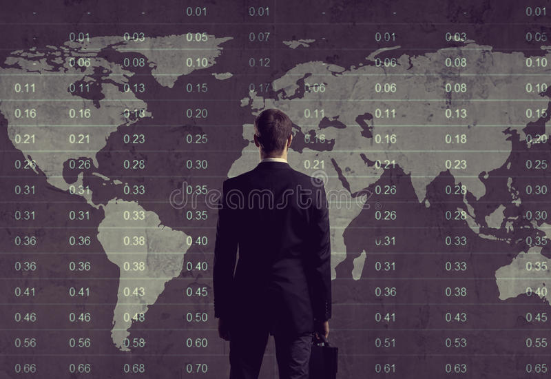 Businessman standing over diagram. World map background. Business, office, career concept. royalty free stock photo