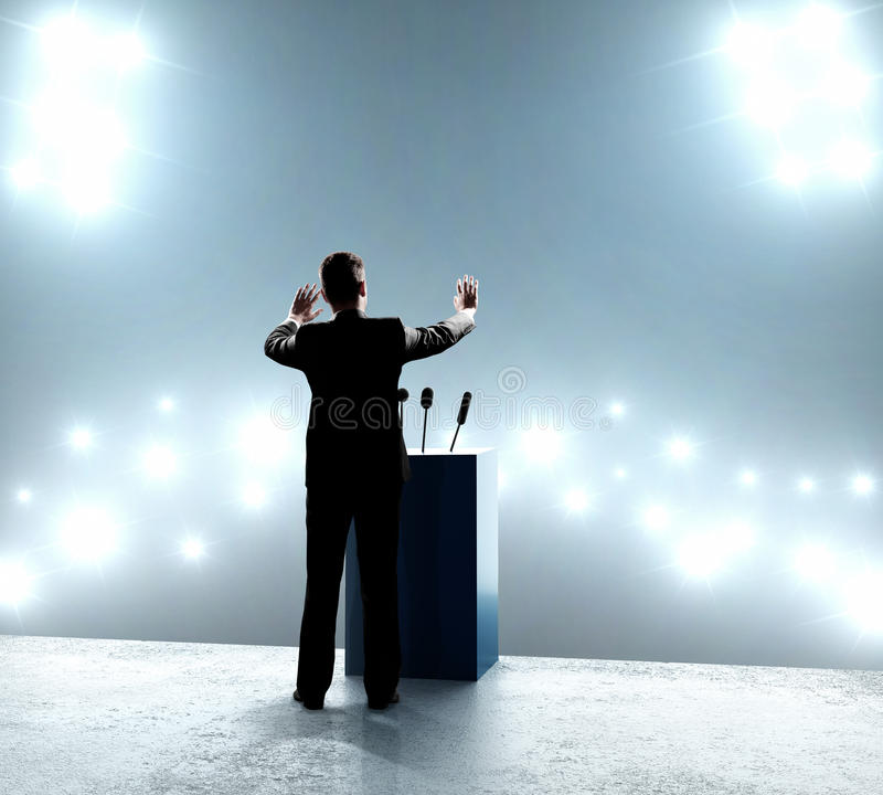 Businessman standing on podium. And closes on outbreaks stock photography