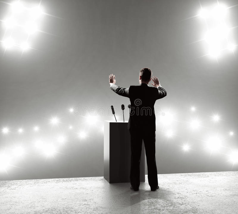 Businessman standing on podium. And closes on outbreaks royalty free stock photography