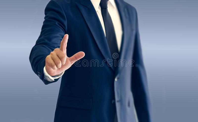 A businessman is standing and pointing hand. stock photo