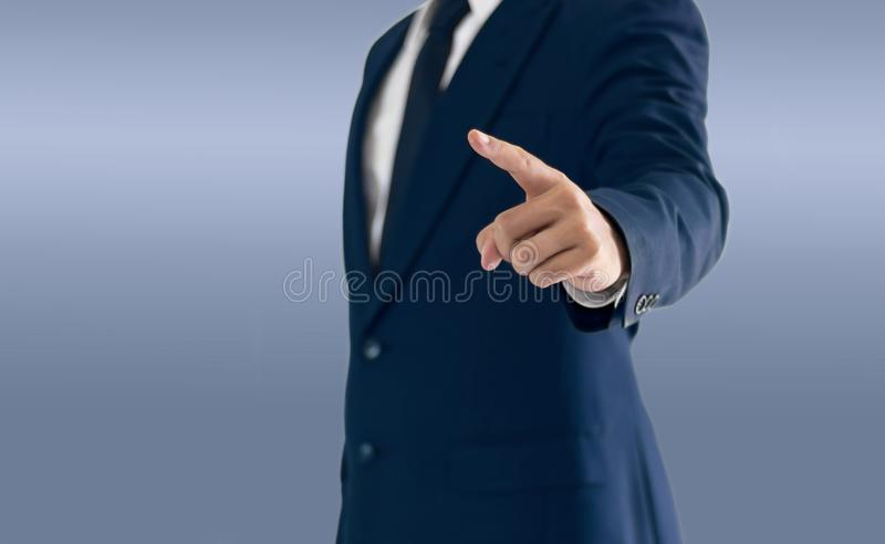 A businessman is standing and pointing hand. stock photography