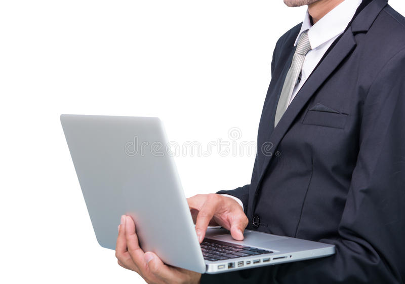 Businessman standing posture hand hold notebook laptop isolated. On over white background royalty free stock images