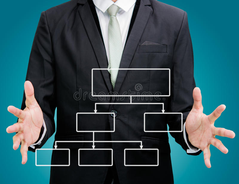 Businessman standing posture hand holding strategy flowchart iso. Lated on over blue background stock image