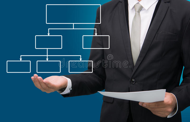 Businessman standing posture hand holding strategy flowchart iso. Businessman standing posture hand holding strategy flowchart on over blue background royalty free stock photos