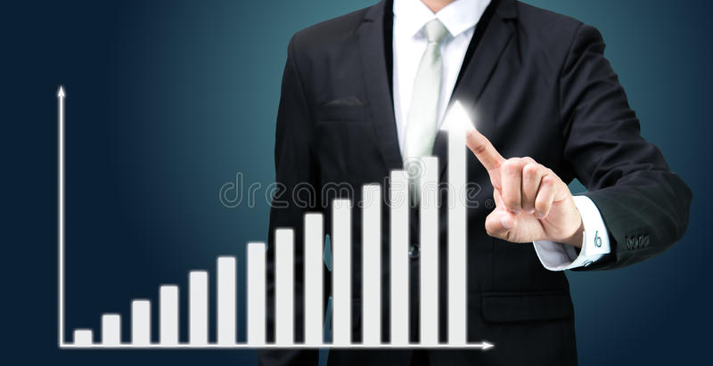 Businessman standing posture hand touch graph finance isolated. On dark background royalty free stock photos