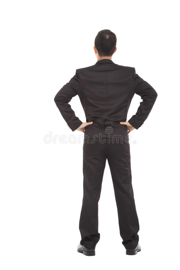 Businessman standing and put hand on waist. royalty free stock photo