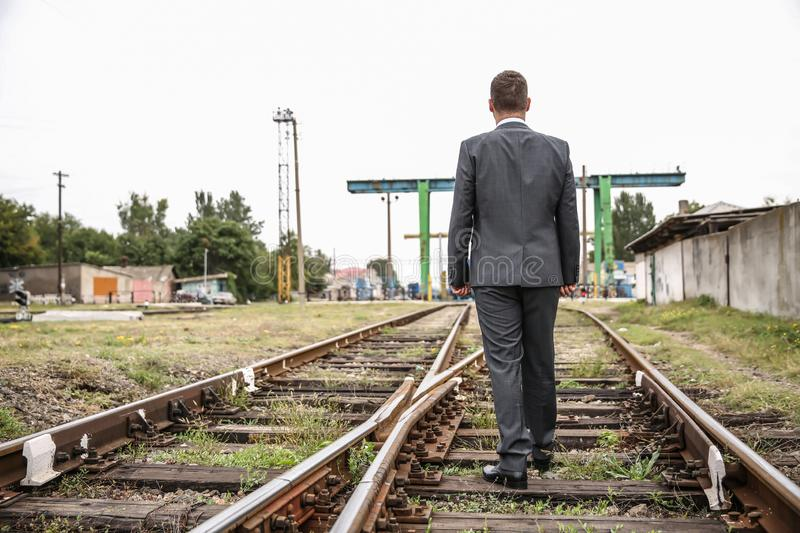 Businessman standing on railway track. Concept of choice royalty free stock photos