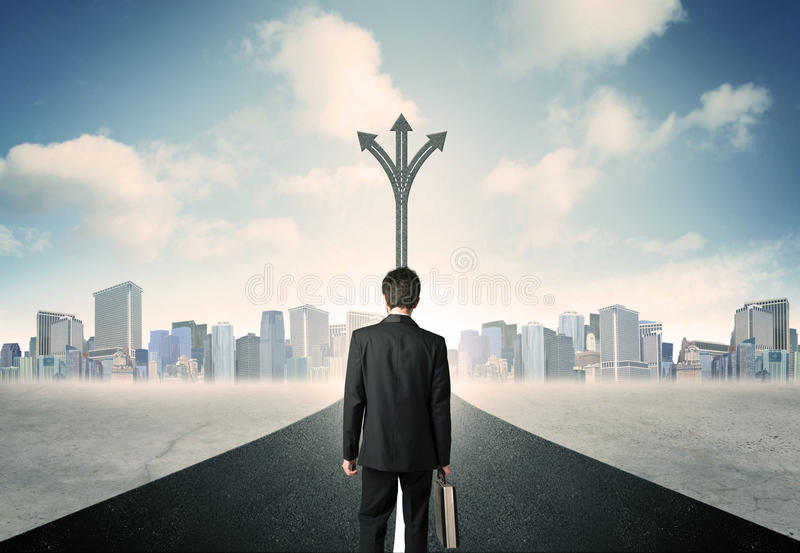 Businessman standing on the road royalty free stock images