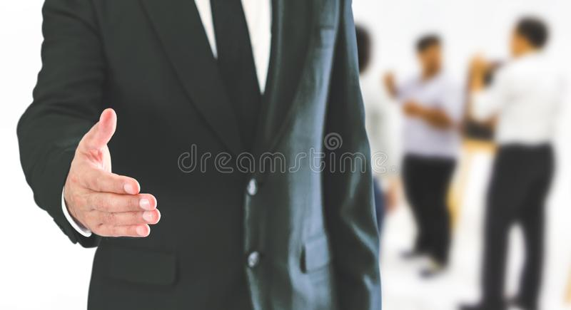 A businessman is standing and shaking hands. stock photography