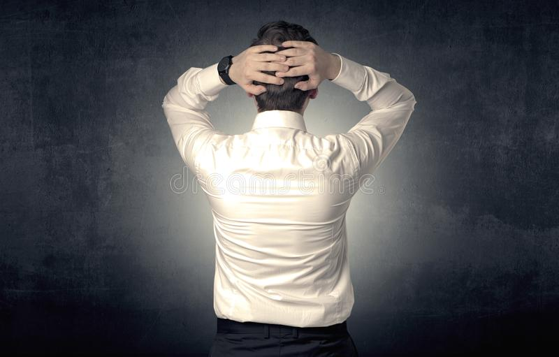 Businessman standing and thinking stock images