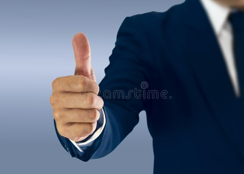 Businessman standing and thumbs to express preferences. royalty free stock images