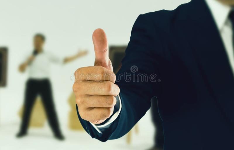 Businessman standing and thumbs to express preferences. royalty free stock photos