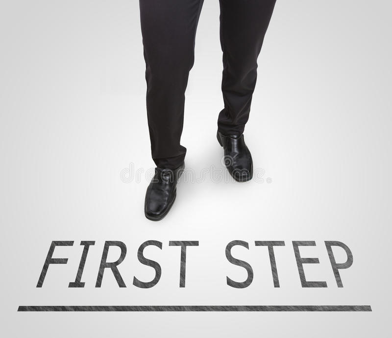 Businessman standing wearing court shoes on first step line. royalty free stock image