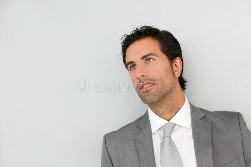 Businessman standing on white background royalty free stock photography