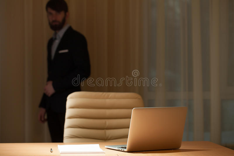 Businessman standing at window royalty free stock photography