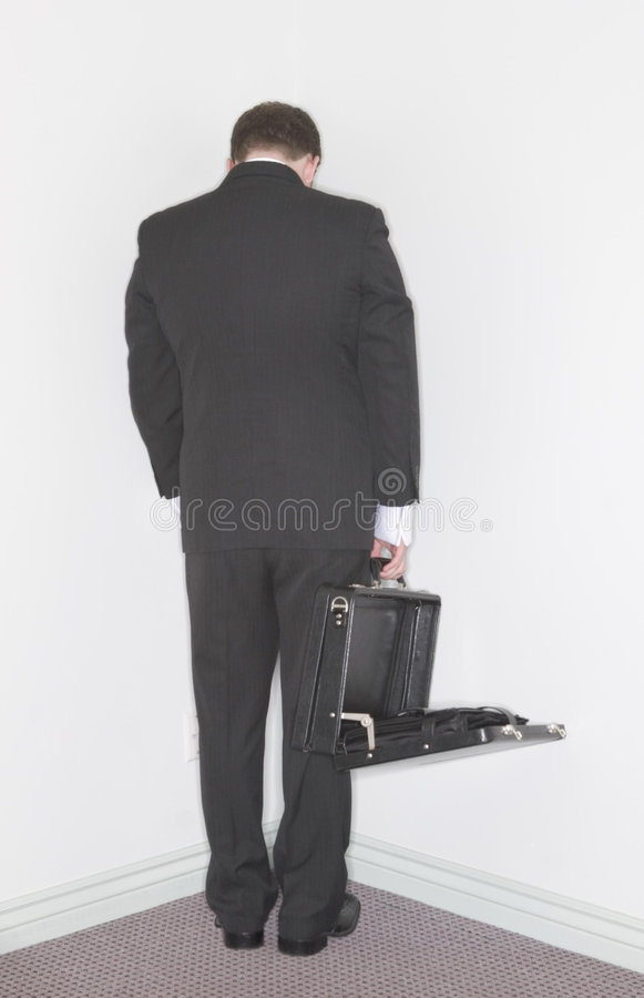 Businessman stands in the corn stock photo