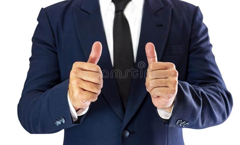 A businessman stands elegantly dressed in a blue suit and thumb royalty free stock photos