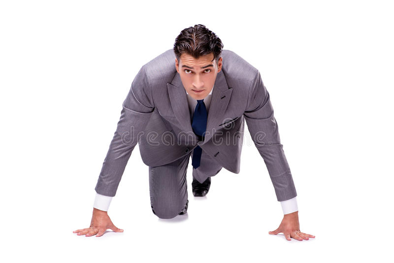 The businessman on start ready for running isolated on white stock photo