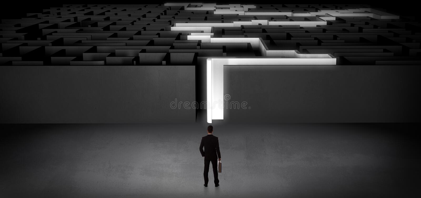 Businessman starting a stated dark labyrinth. Businessman getting ready to enter the dark labyrinth with stated road concept stock photography