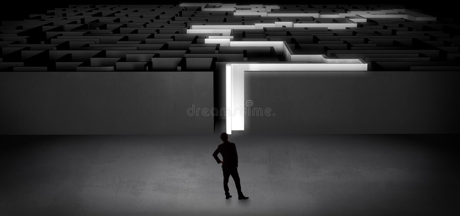 Businessman starting a stated dark labyrinth. Businessman getting ready to enter the dark labyrinth with stated road concept royalty free stock image