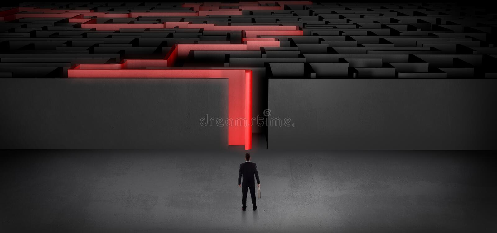 Businessman starting a stated dark labyrinth. Businessman getting ready to enter the dark labyrinth with stated road concept royalty free stock photos