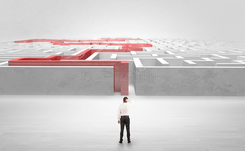 Businessman starting a stated labyrinth. Businessman getting ready to enter the labyrinth with stated road concept stock photos