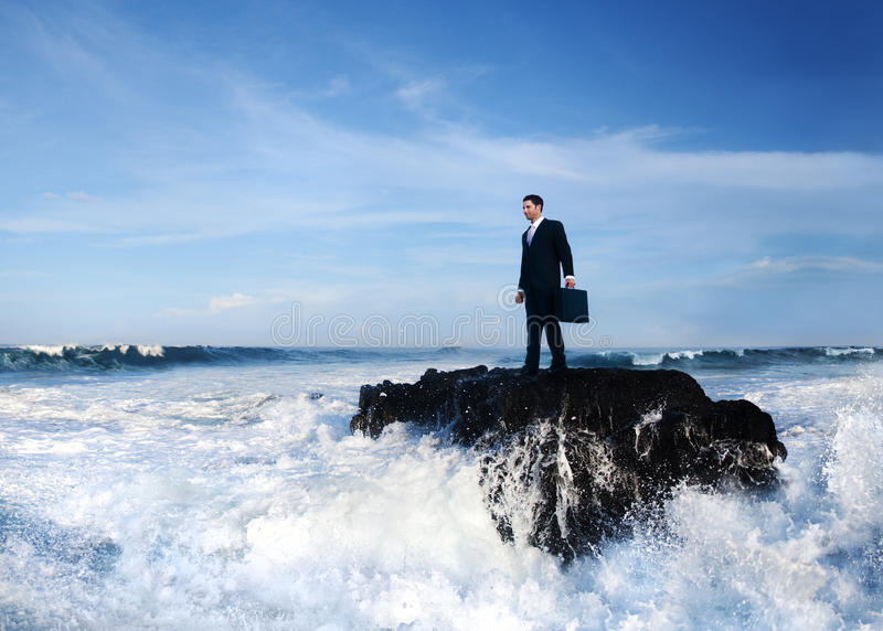 Businessman Staying Alone on the Island royalty free stock photography