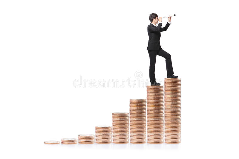 Businessman Step On Money And With Telescope Stock Photos