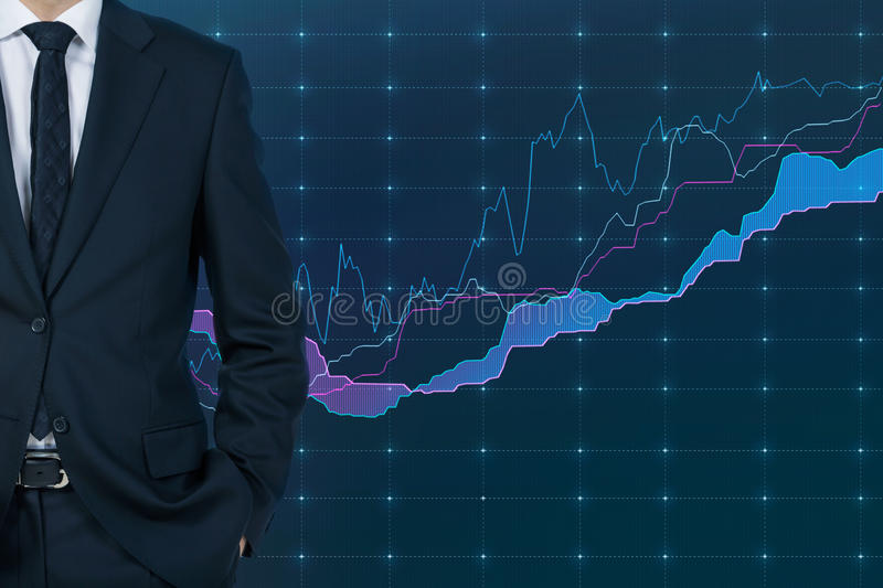 Businessman and stock chart. Businessman standding and chart on virtual screen royalty free stock photography