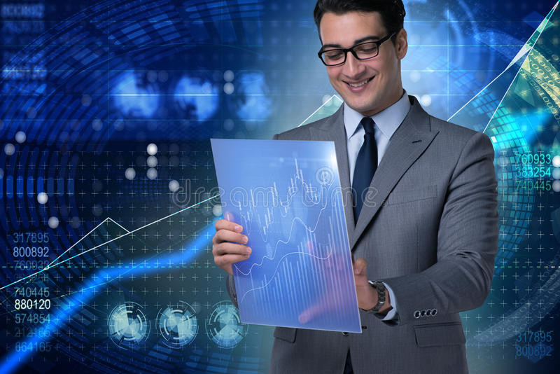 The businessman in stock exchange trading concept. Businessman in stock exchange trading concept stock photos
