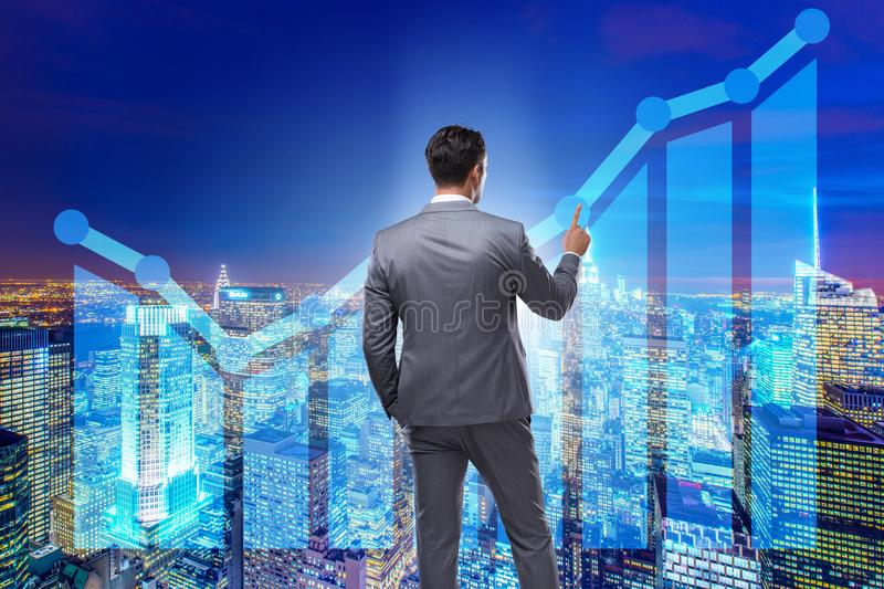 The businessman in stock trading concept. Businessman in stock trading concept royalty free stock photography