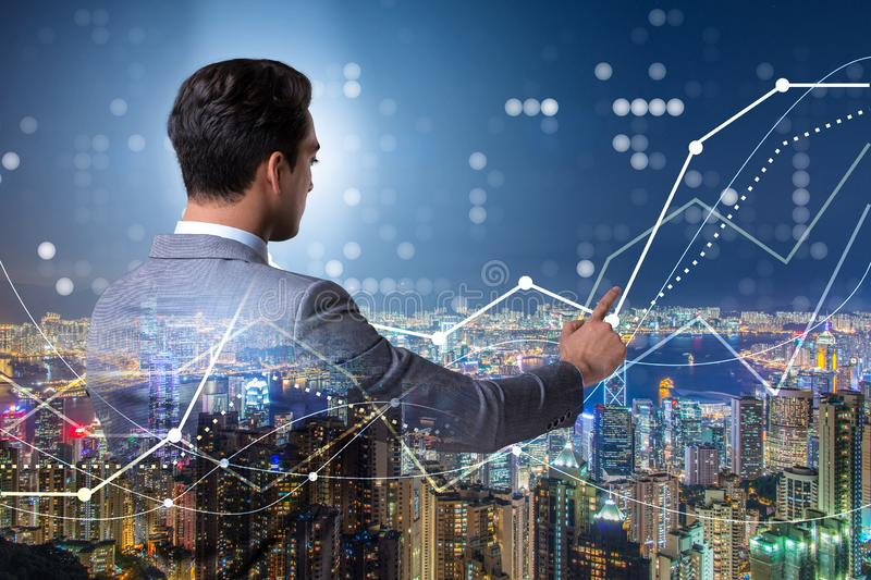 Businessman in stock trading concept. The businessman in stock trading concept royalty free stock photos
