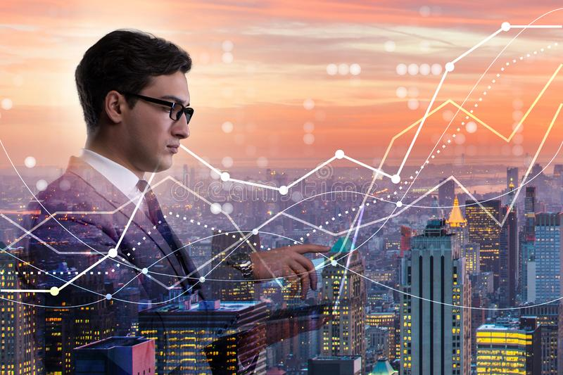 The businessman in stock trading concept. Businessman in stock trading concept stock photo