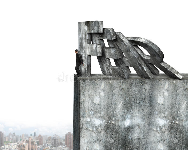 Businessman stopping domino of red fear word falling stock photos