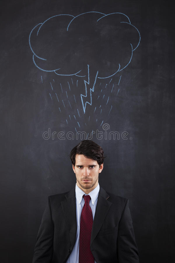 Businessman with a storm cloud abouve his head royalty free stock image