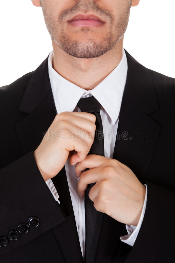 Download Businessman Straightening His Tie Stock Photo - Image of face, black: 28707190
