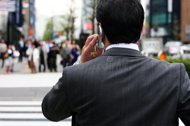 Businessman on the street. Businessman talking on the phone on the street stock photography