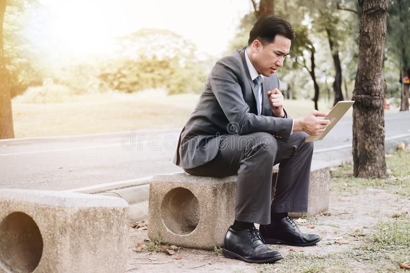 Businessman Stressed out with sale report with tablet computer r stock photo
