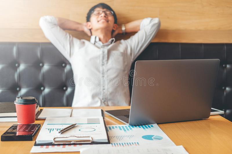 Businessman stretched relaxing enjoying his success of work in office royalty free stock photography