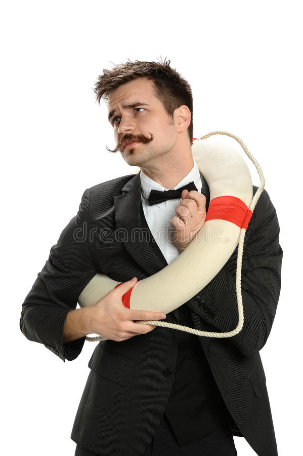 Businessman Struggling To Fit into Life Ring royalty free stock photography