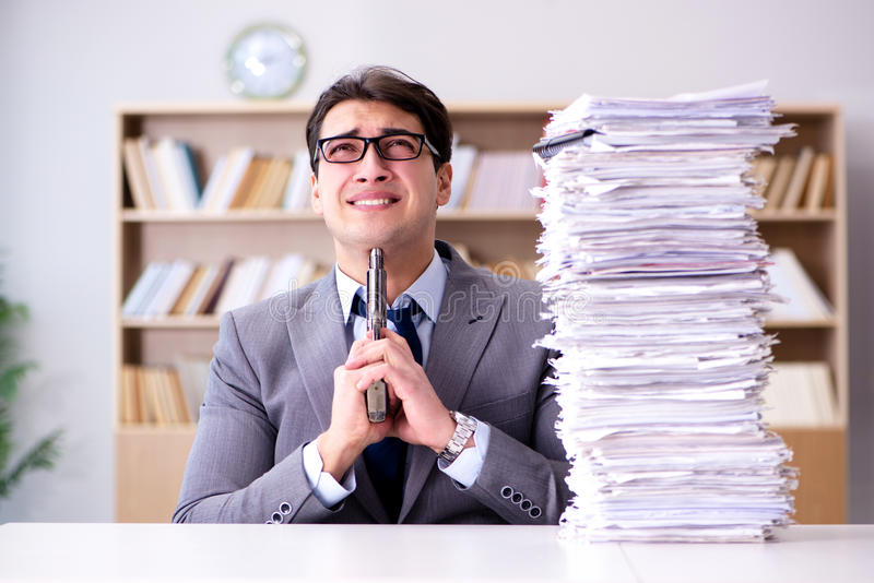 The businessman struggling to meet challenging deadlines. Businessman struggling to meet challenging deadlines stock photos