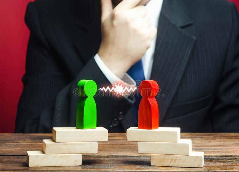 A businessman is studying confrontation of opponents, rivalry parties. Truce agreement. Resolution disputes, compromise. Establishing contact. Candidates royalty free stock photos
