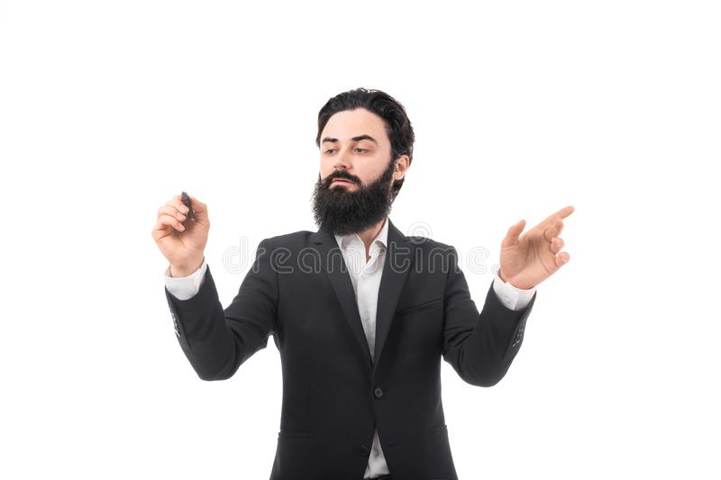 Businessman with stylus. Bearded businessman touching invisible screen and writes with stylus isolated on white background royalty free stock photo