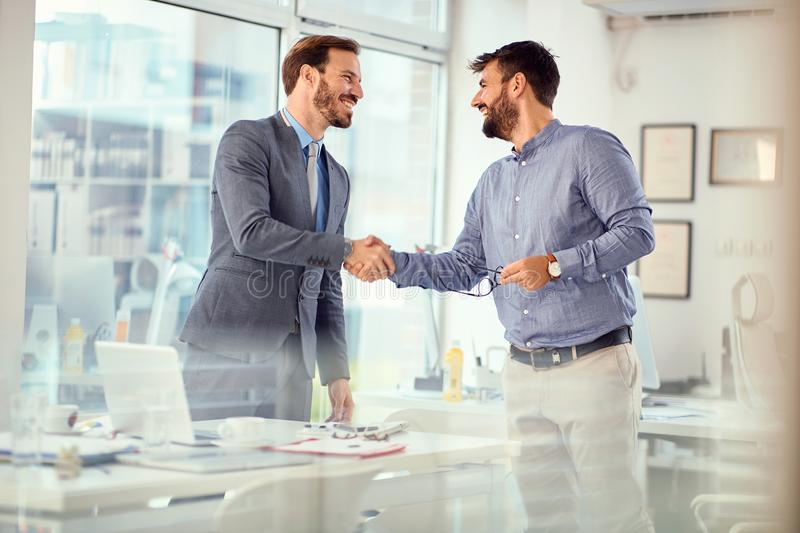 Businessman successfully completed business meeting with clients. Businessman successfully completed business meeting with smiling clients royalty free stock images